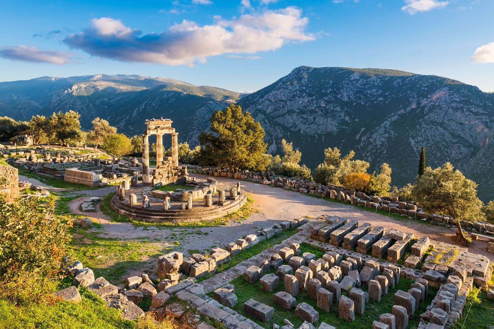 Ruins of the Temple of Athena Pronaia in ancient Delphi, Greece shutterstock_1246195618