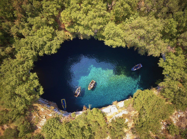 On top of Melissani Cave ( Melissani Lake) near Sami village in Kefalonia island , Greece shutterstock_681616111