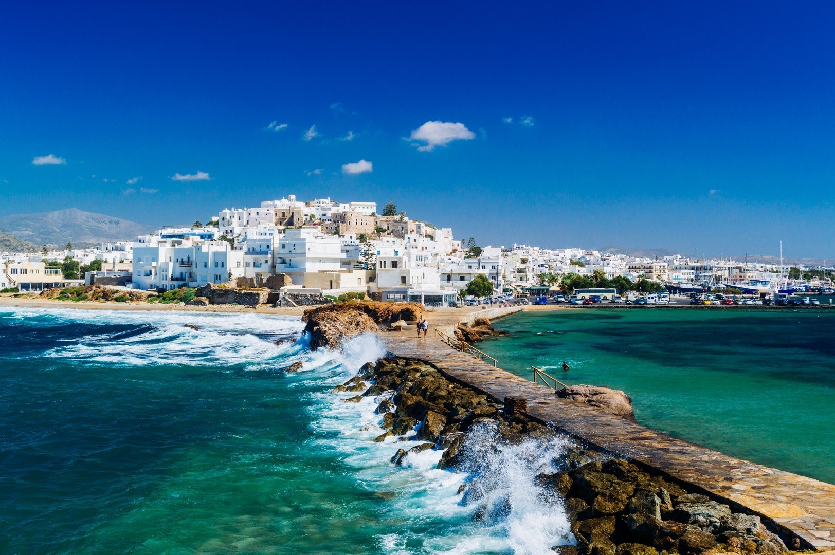 View of Naxos town and breaking waves, Cyclades archipelago, Greece shutterstock_553009312