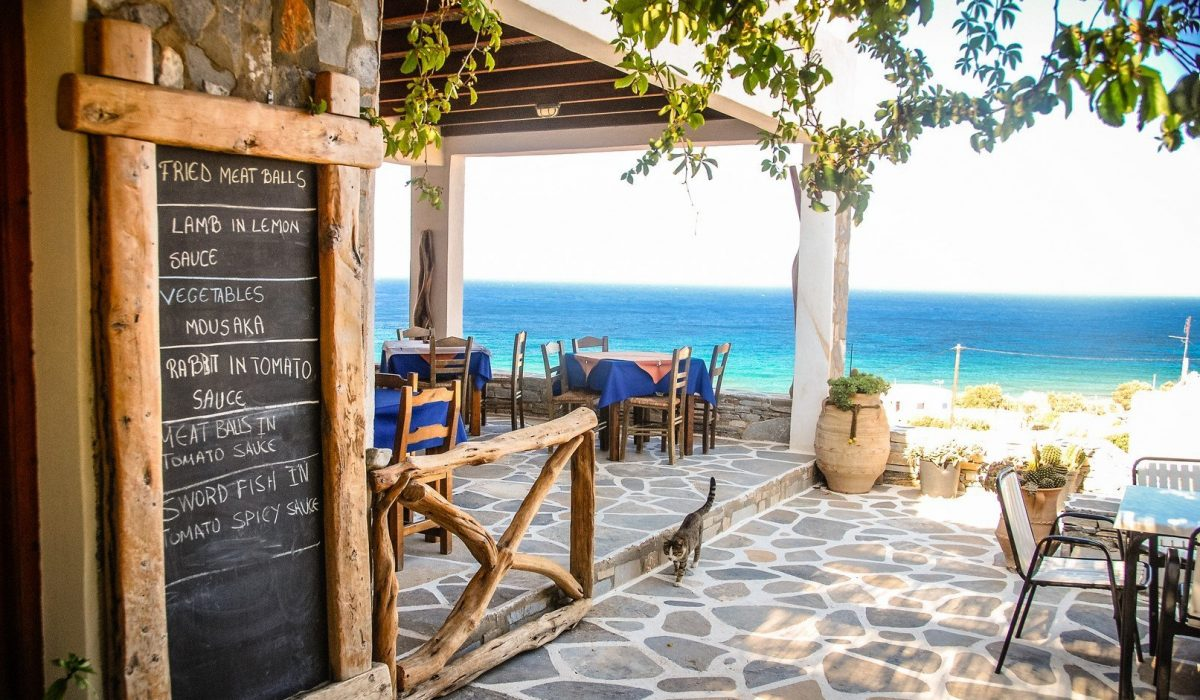 A Taverna in Ios, Greece with the chalk menu-board outside shutterstock_412726207