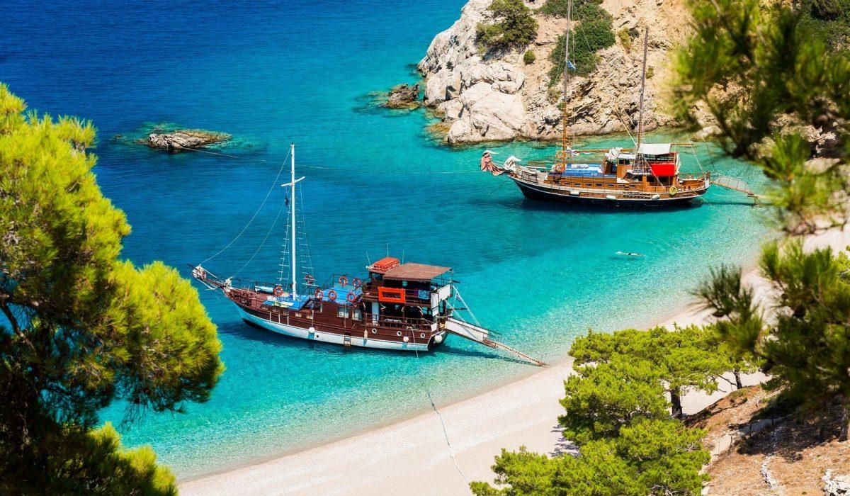 Beautiful Apella beach hidden between high mountains in Karpathos island. Greece. shutterstock_321595250