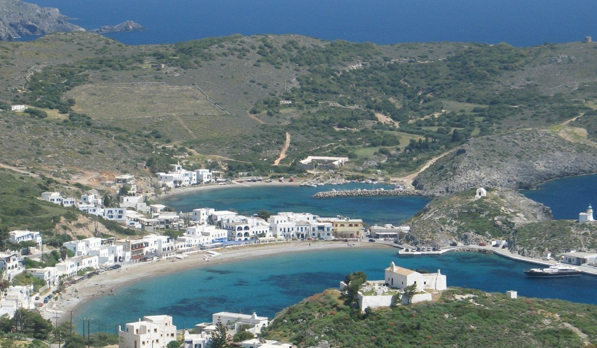 An aerial view of the blue-watered bays of Kapsali, island of Kythira, Greece, stemmed by the typical island white houses