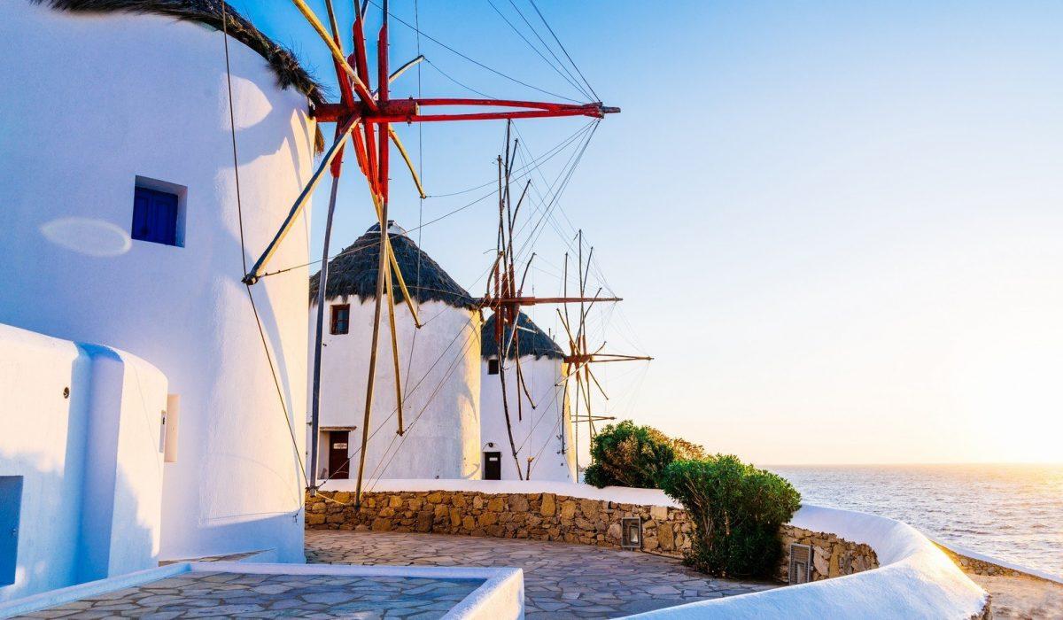 Famous Mykonos town windmills in a romantic sunset, Mykonos island, Cyclades, Greece shutterstock_458827306