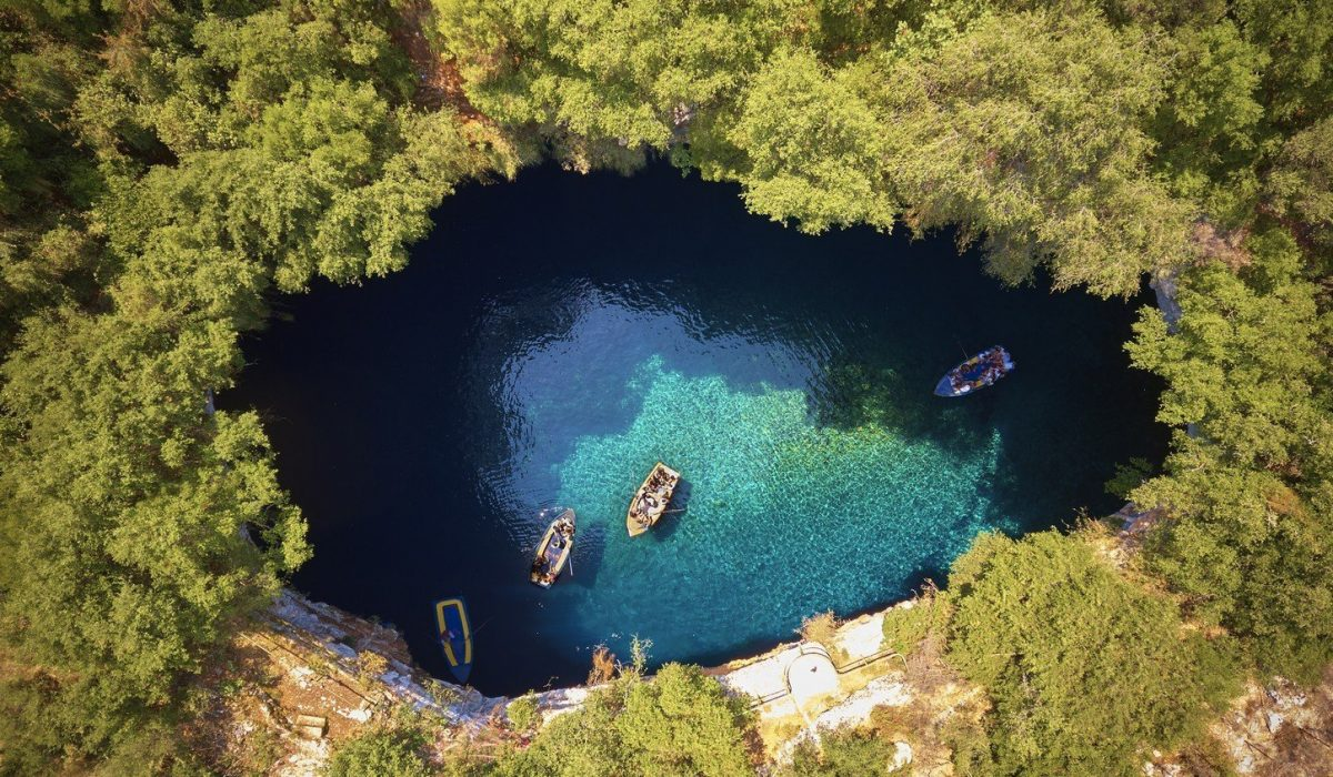 On top of Melissani Cave ( Melissani Lake) near Sami village in Kefalonia island , Greece shutterstock_681616111