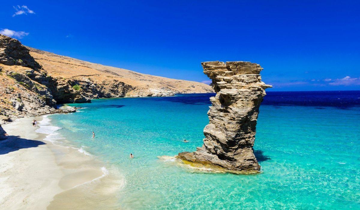 Turquoise beautiful beaches of Greece - Andros island, Tis Grias To Pidima beach shutterstock_554001355